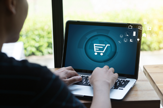 Person shopping online on laptop